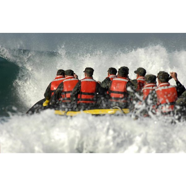 Group of Navy SEALS training on the water.