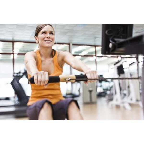 A woman works out on a machine at the gym.
