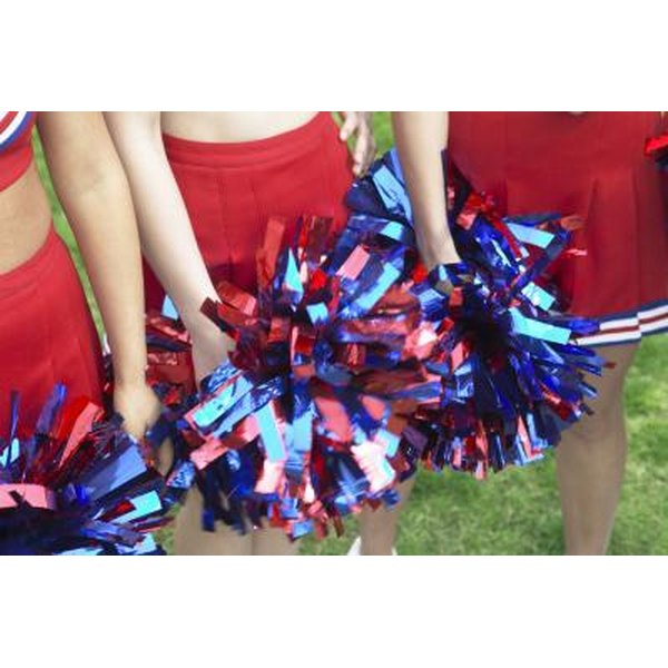 Cheerleaders holding pom pons.