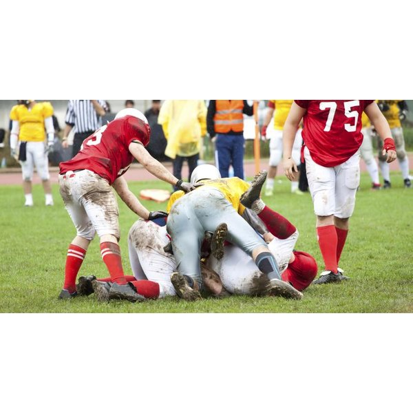 Football player getting tackled.