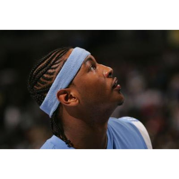 Braids and headbands are two ways to keep your vision clear when rebounding, shooting or passing.