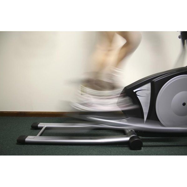 Woman using an elliptical machine.