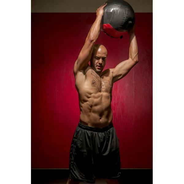 Medicine balls are one type of implement you can use for wood chops.