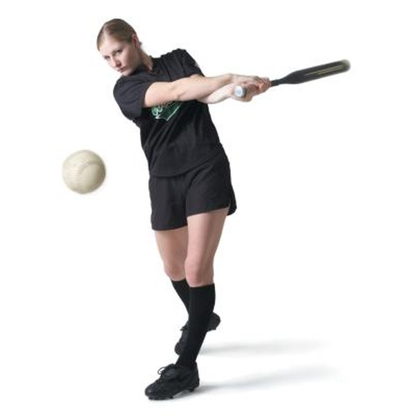 Practice your softball swing with drills that include heavy bats and colored softballs.