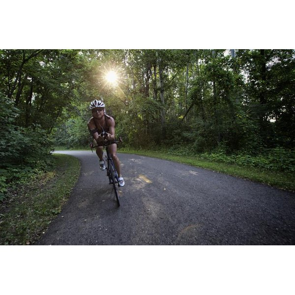 A woman is out on her road bike.