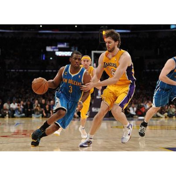 Good ballhandlers like Chris Paul (left) can use either hand on the dribble.