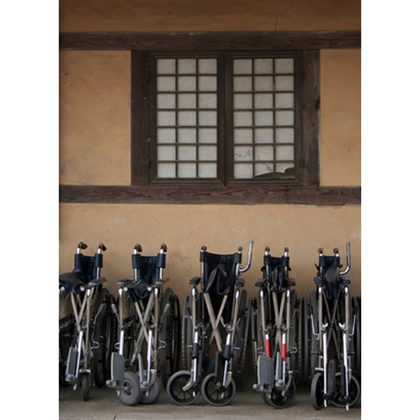 School shown with folded wheel chairs leaning against wall.