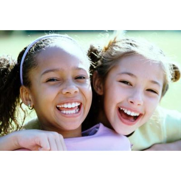 A portrait of two young friends laughing together.