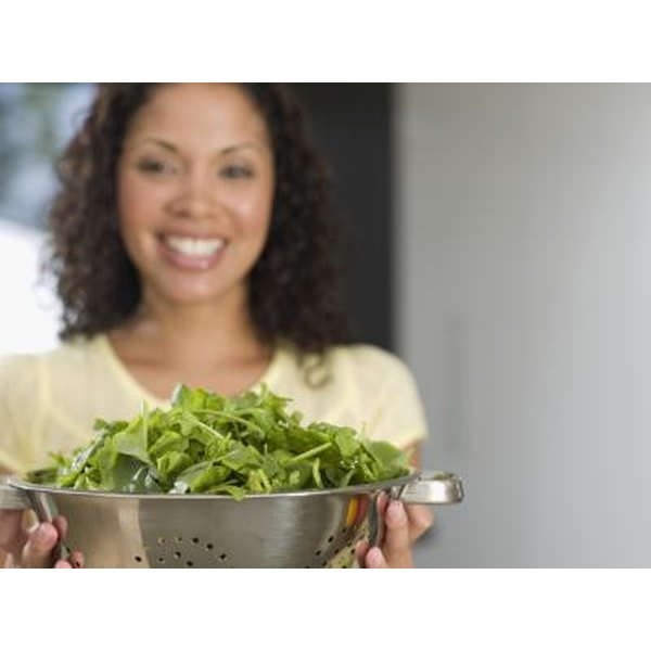 woman holding a salad