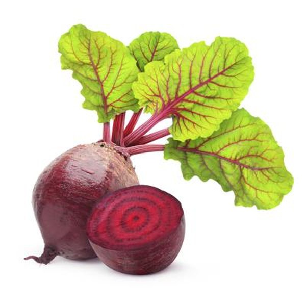Fresh beets with green leaves attached.