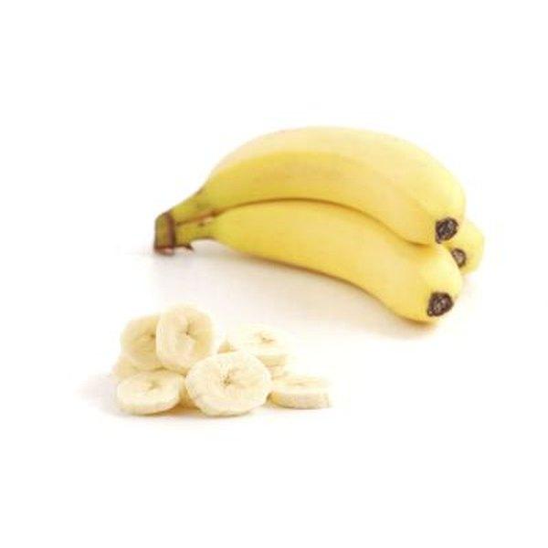 Whole banana with sliced banana pieces.