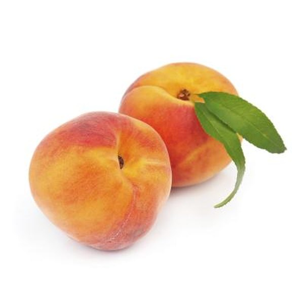 Sweet peaches on white background.