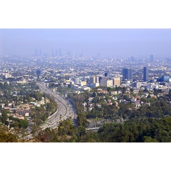 An aerial view of Los Angeles with a smog over the city.