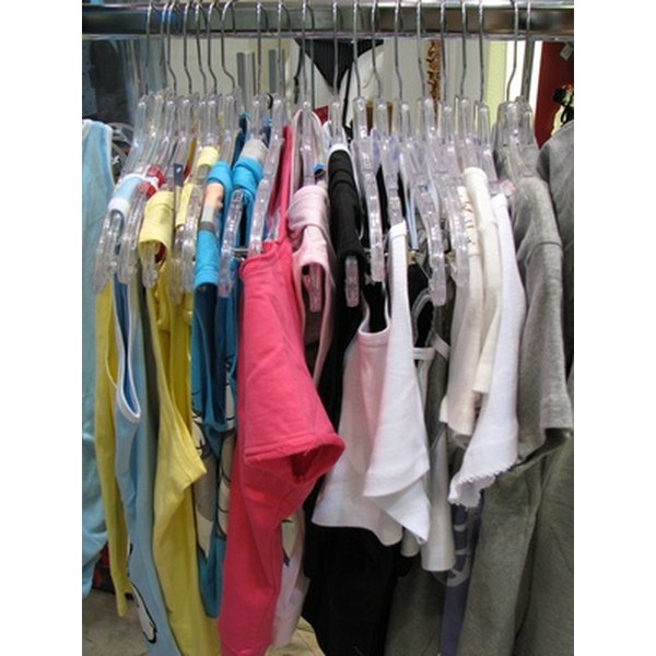 Clothing racks display merchandise in varied styles, sizes and colors.