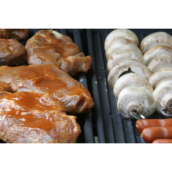 Metal smoker boxes add hardwood smoke flavor to a variety of foods prepared on gas grills.