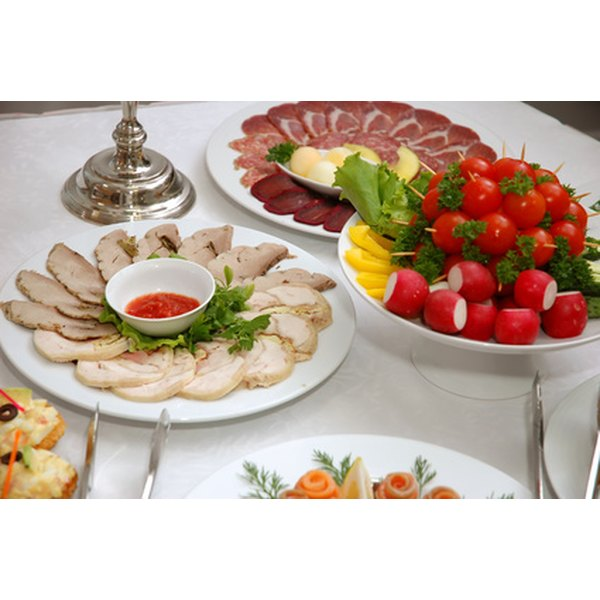 Arrange a buffet table that guests will enjoy looking at as they fill their plates.