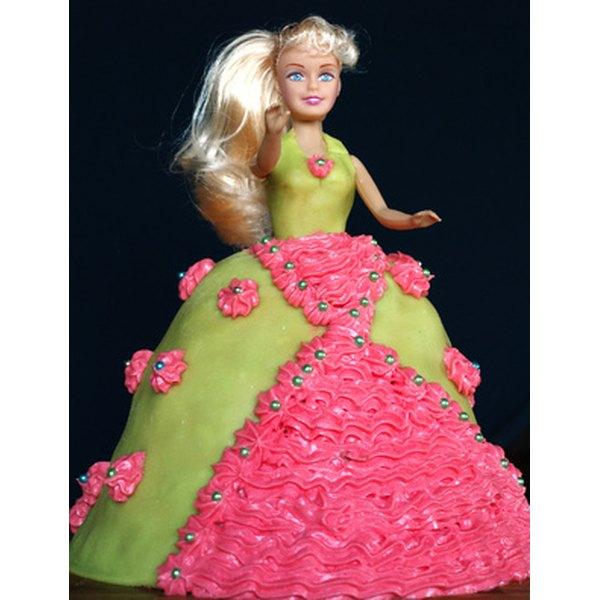 Bake a dome-shaped cake to create a Barbie doll cake.