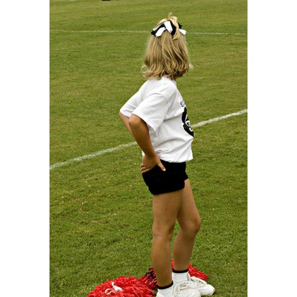 Use megaphones and pom poms to help achieve your cheerleading theme.