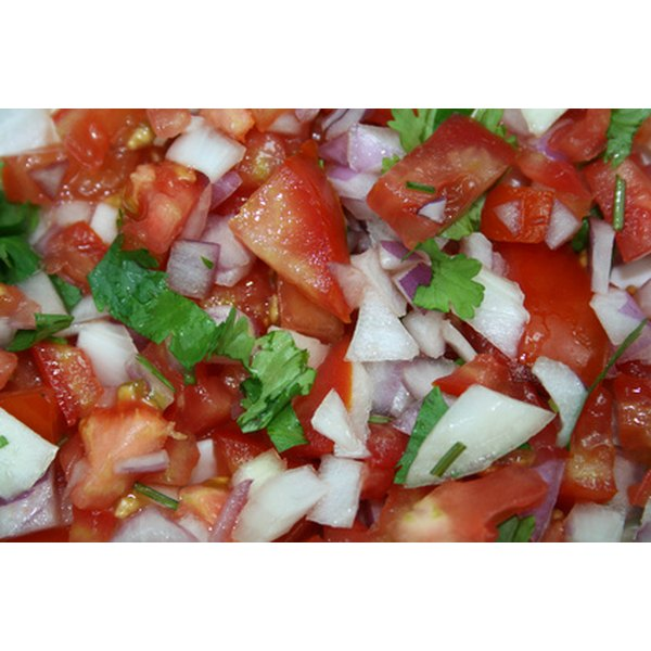Fresh cilantro and onions can be chopped with tomatoes for a salsa that will enhance any quesadilla.
