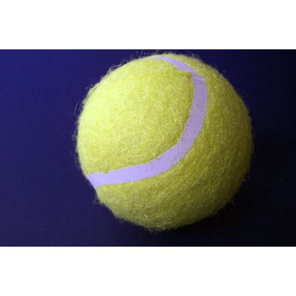 A tennis ball can help to relieve painful knots in your shoulder blades.
