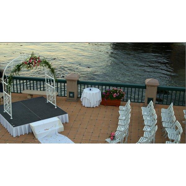 Couples often exchange vows under a wedding arbor.