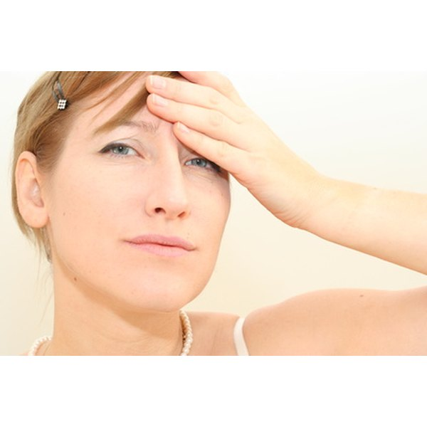 Stress is one of many factors that can cause purple under-eye bags.