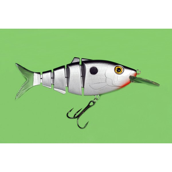 Attach tickets for a fishing trip to the end of a hook.