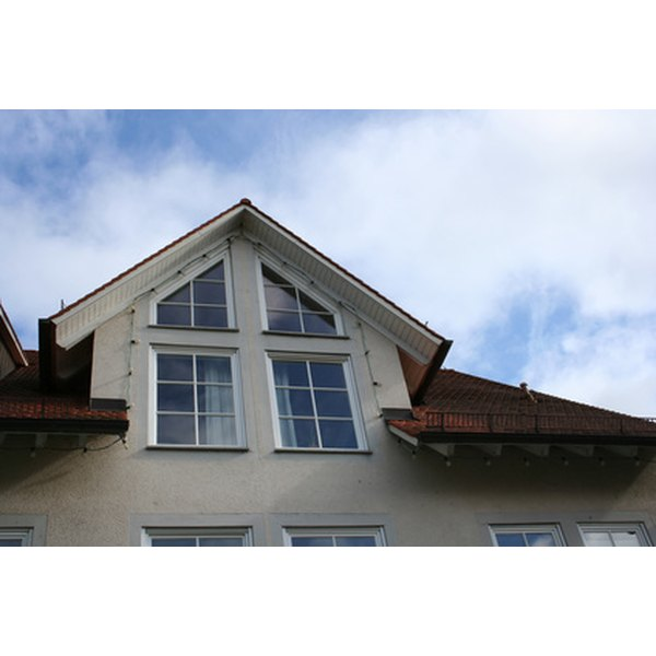 Remove foam insulation from vinyl window frames.