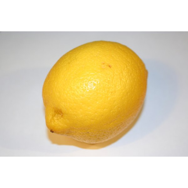Zest and juice a lemon properly to add flavor to food and beverages.