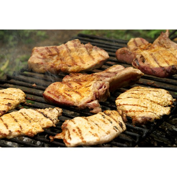 Smoked porkchops come off tender when slow-cooked on a gas grill.