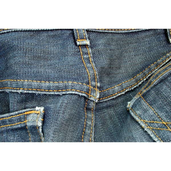 Remove stains from denim, using various home remedies, such as vinegar and rubbing alcohol