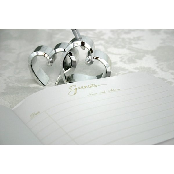 Write a touching note to the bride and groom in their wedding memory book.