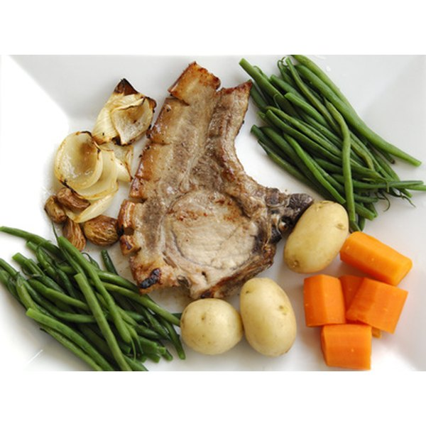 Pork chops pair well with carrots, potatoes and green beans.