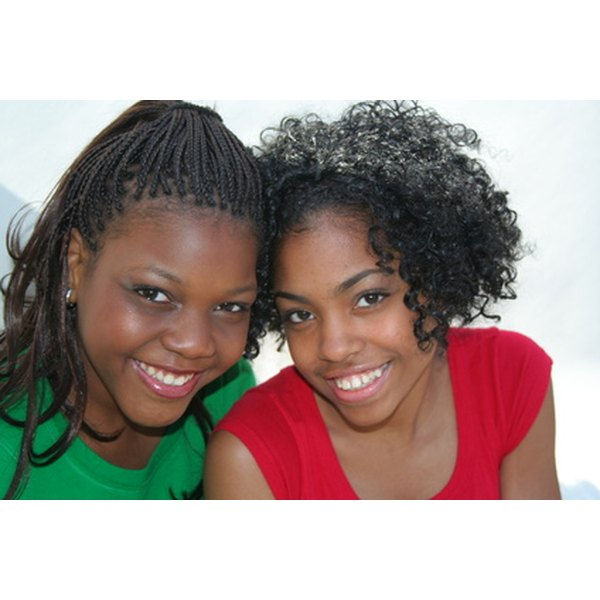 African American teens should keep their makeup natural with warm, shimmery eye shadow and sheer lip gloss.