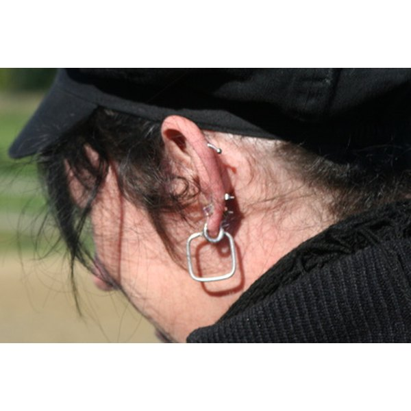 Make ear piercings larger with tapers.