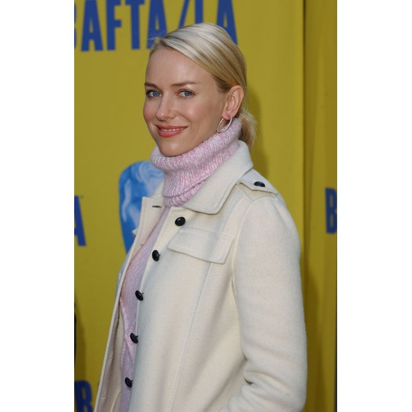 Naomi Watts wears a turtleneck sweater under a wool peacoat.