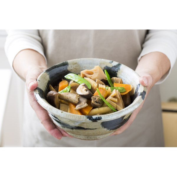 A bowl of Japanese mushrooms and vegetables.