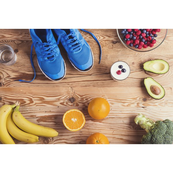 An overhead view of running shoes and healthy foods.