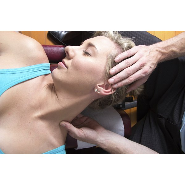 A woman is receiving chiropractic care.