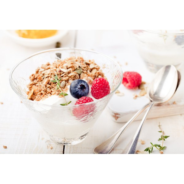 A dish of yogurt topped with whole grains and seeds.