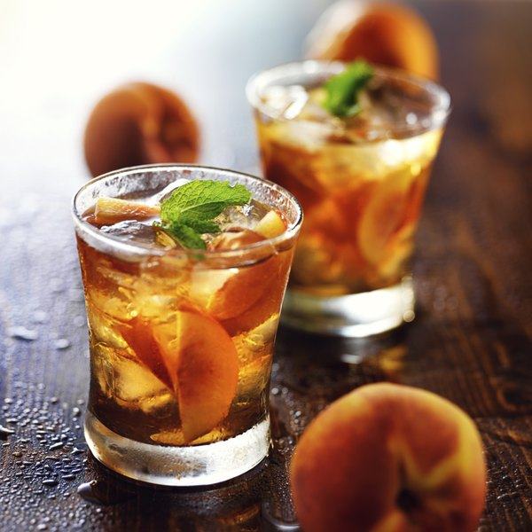 Two peach cocktails with peaches.