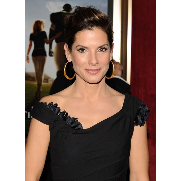 Actress Sandra Bullock sports a glamorous side puff on the red carpet.