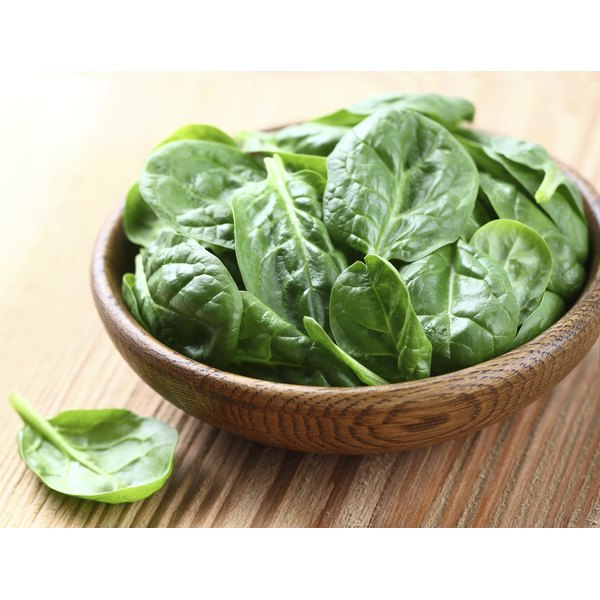 Baby spinach in a wooden bowl