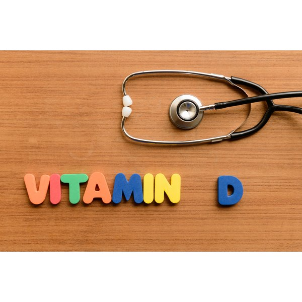 Letters spelling out Vitamin D with a stethoscope.