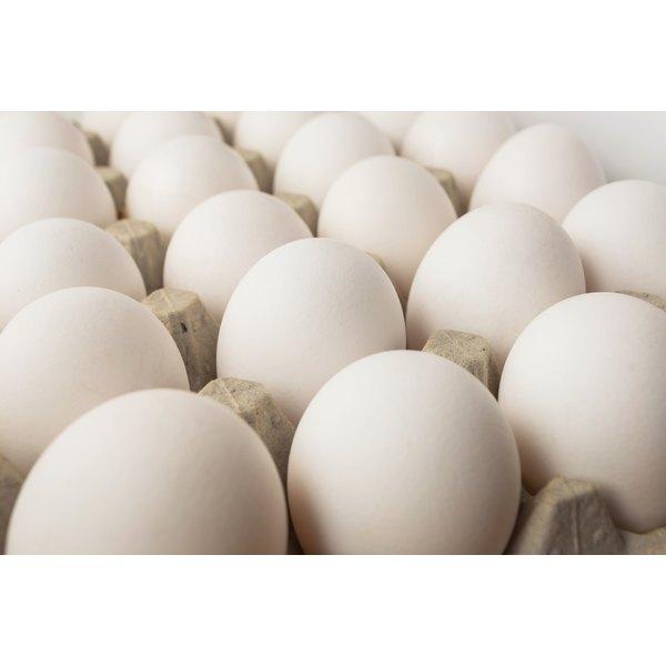 Brown eggs in a carton.