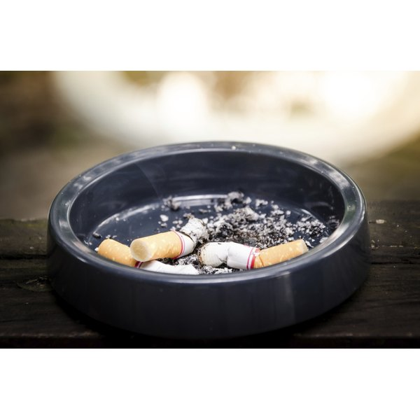 An ashtray with extinguished cigarettes.