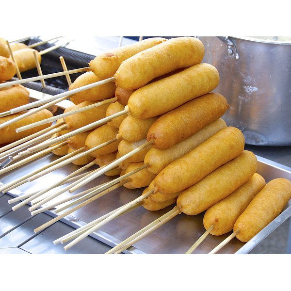Corndogs for sale at a food cart.