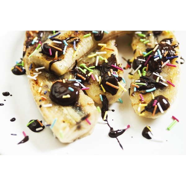 Serve the grilled bananas with sweet toppings like chocolate sauce and sprinkles.