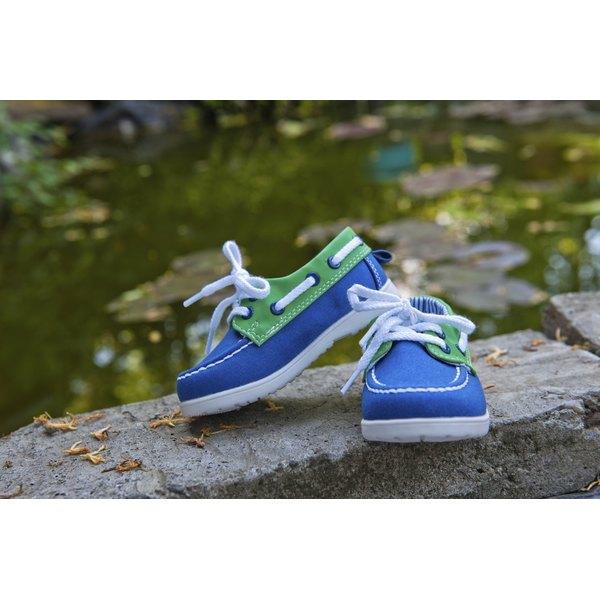 Boys shoes on rocks