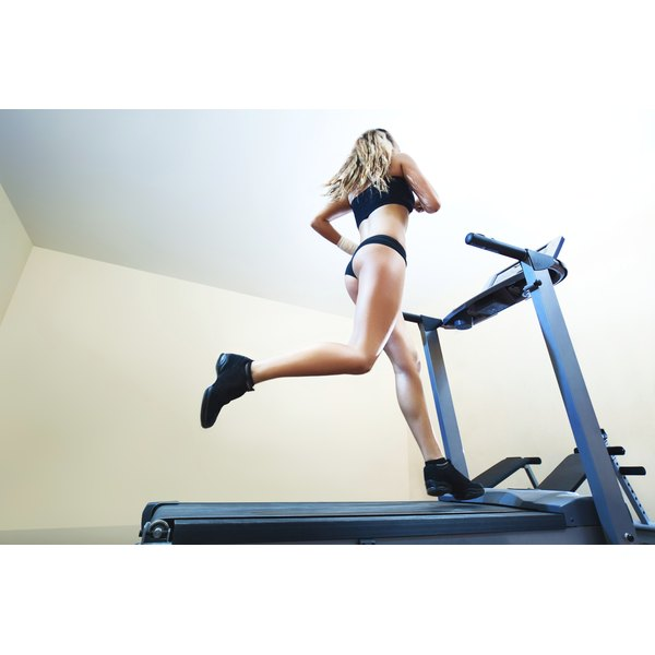 A woman is jogging on a treadmill.